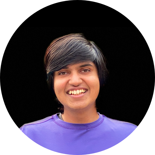 vardhan agrawal smiling in a circular profile photo with black background and purple t-shirt