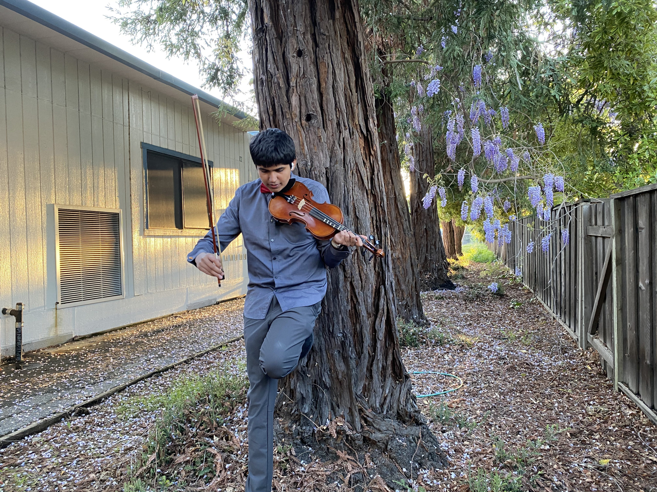 Vardhan Agrawal playing the violin while recording a cover and music video of Schindler's List