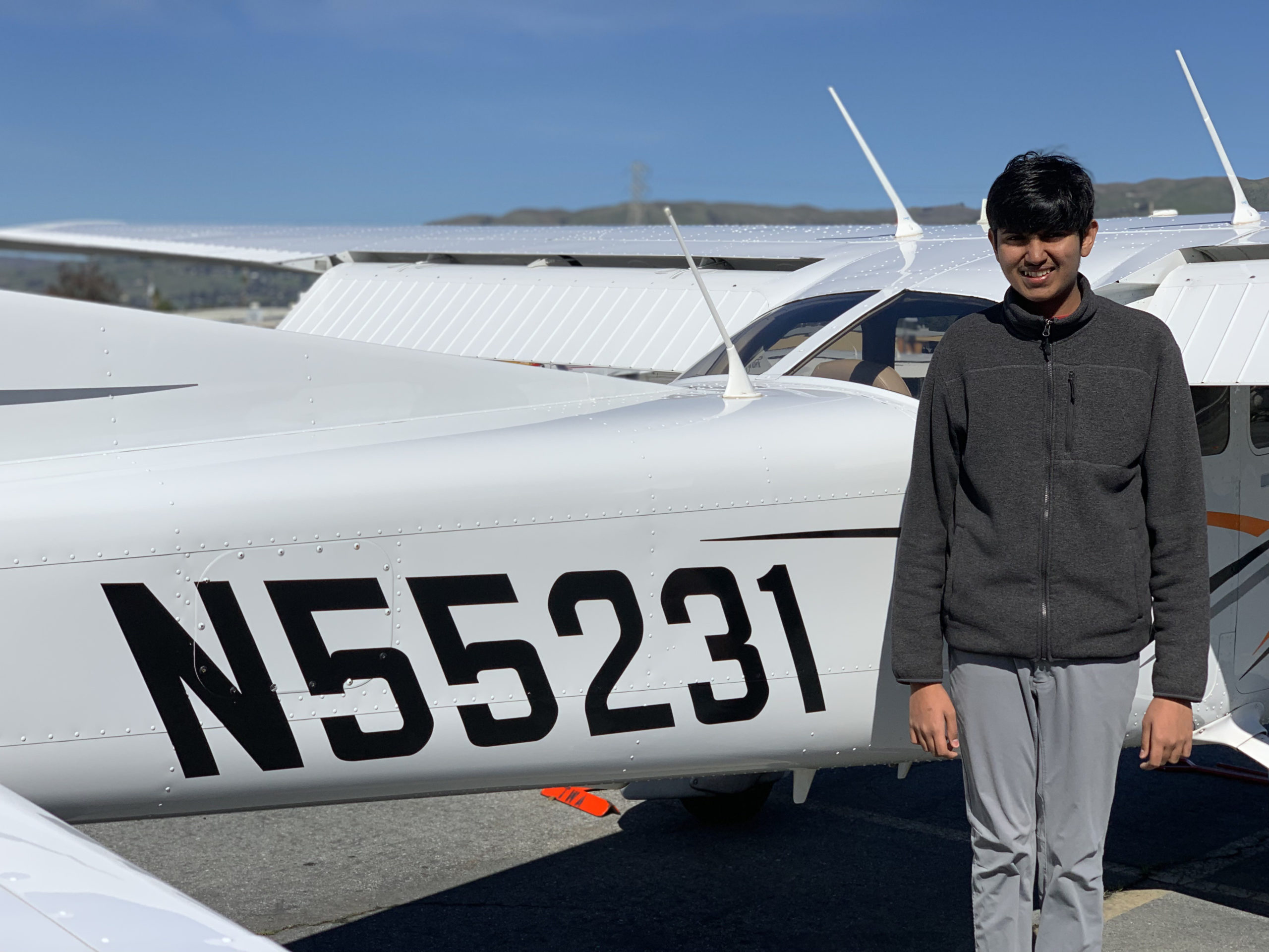 Vardhan Agrawal next to a Cessna 172S after one of his flight lessons
